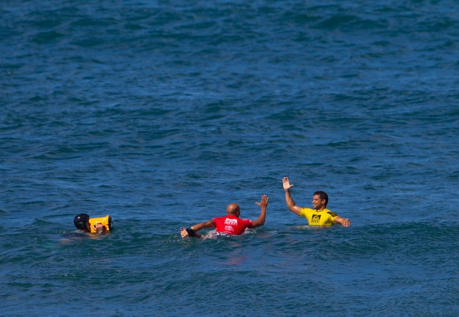 Fred Patacchia Jnr. congratulates Michel Bourez on his win at the Reef Hawaiian Pro.   © ASP / Kirstin