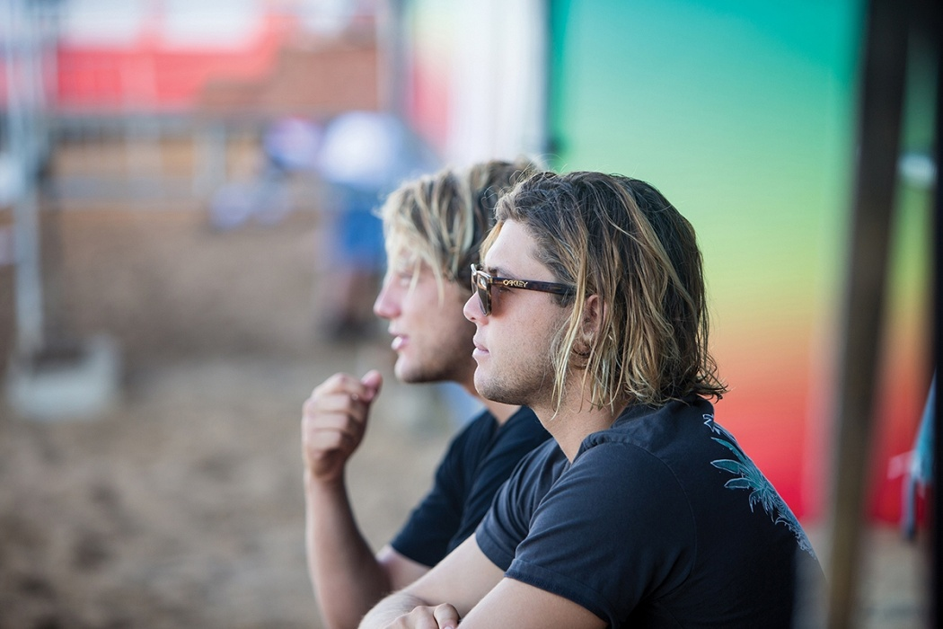 Brothers Conner and Parker Coffin watch the lineup at Haleiwa.   © WSL / Heff