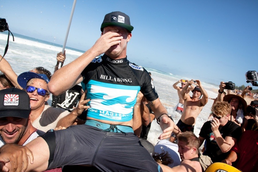 Mick Fanning (AUS) is overcome with emotion as he is chaired up the beach as the 2013 ASP World Champion.   © ASP / Cestari