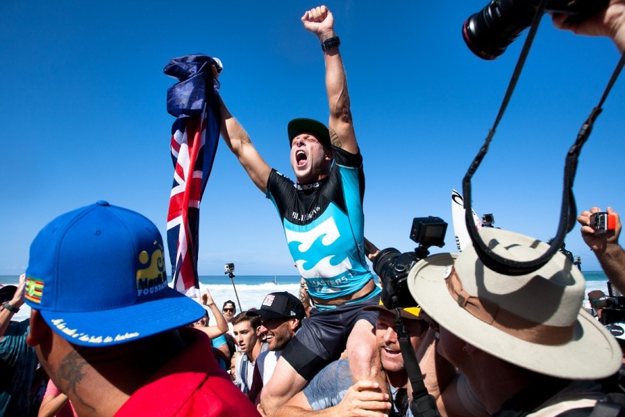 Mick Fanning (AUS) is chaired up the beach as the 2013 ASP World Champion after winning his Billabong Pipe Masters Quarter Final heat.   © ASP / Cestari