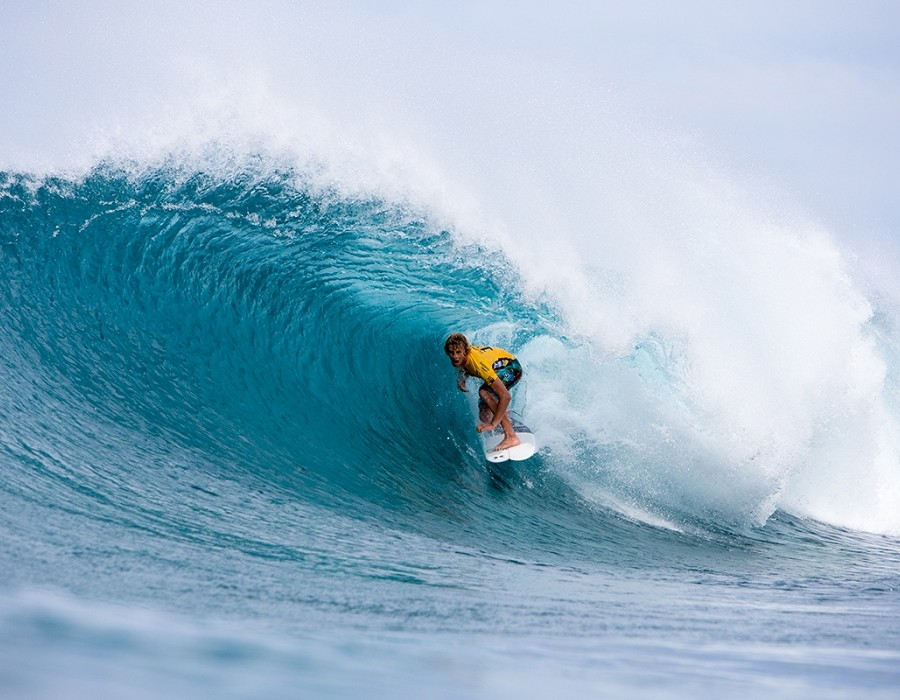 John John Florence goes down in quarterfinal 2 of the Billabong Pipe Masters.   © WSL / Heff