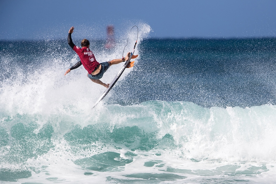 Josh Kerr of Australia advances to round three by placing first in heat 14 of round two.   © WSL / Heff